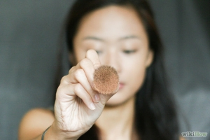 Set the concealer with setting powder. Choose a loose (mineral) powder and dab it on the concealed parts of your face with a stippling brush