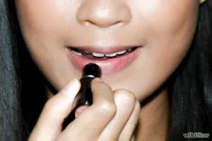 Moisturize your lips by applying chapstick. Use a lip primer to fill up any creases and apply a lip liner, followed by applying a lipstick in the same color as the lip liner and finish with a gloss if you want a glossy look.